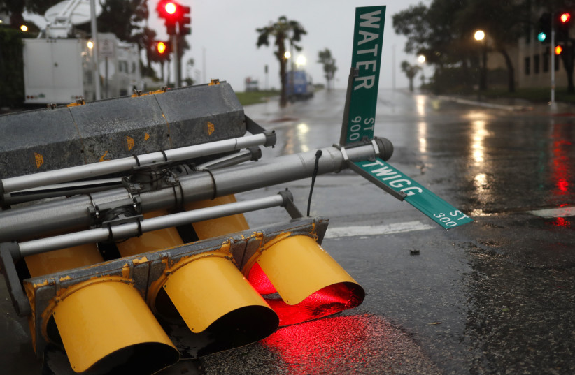 Traffic lights lie on a street after being knocked down, as Hurricane Harvey approaches in Corpus Christi, Texas, US August 25, 2017.  (photo credit: REUTERS)