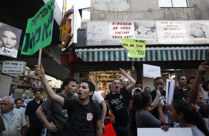 Residents of south Tel Aviv protest against African migrants living in their neighbourhood (photo credit: BAZ RATNER/REUTERS)
