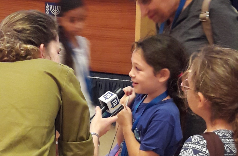 A student is interviewed at the Foreign Ministry's open day for kids, August 2017 (photo credit: HERB KEINON)