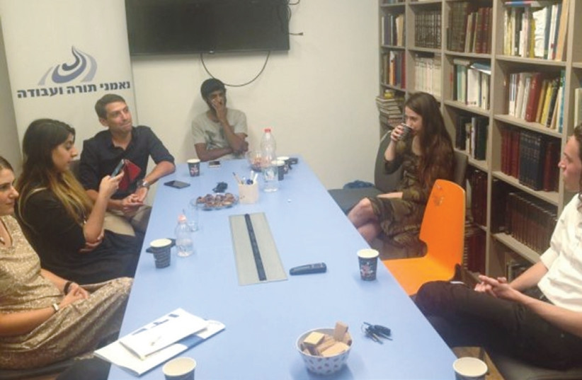 PEOPLE HOLD a discussion at the office of Ne'emanei Torah Va'Avodah, a religious-Zionist lobbying group working to combine 'Torah and science' in education (photo credit: COURTESY NE'EMANEI TORAH VA'AVODAH)