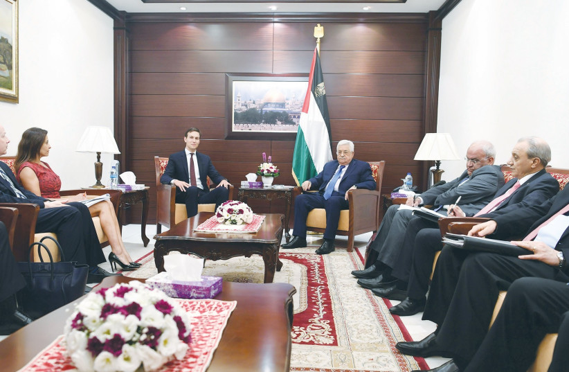 PA President Mahmoud Abbas with US presidential adviser Jared Kushner and lead negotiator Jason Greenblatt in Ramallah (photo credit: REUTERS)