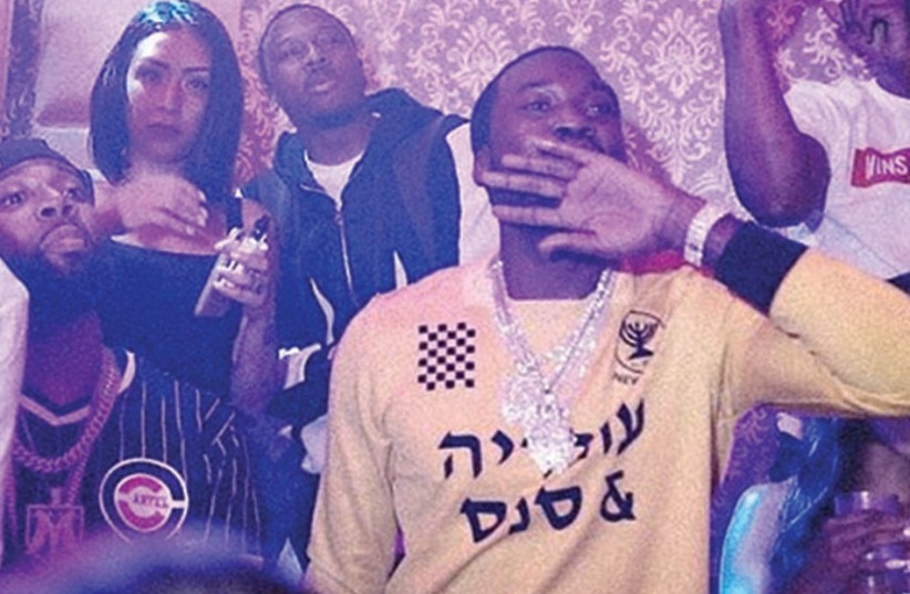 Meek Mill is seen wearing a Hebrew-emblazoned shirt reading 'Ovadia and Sons.' (photo credit: INSTAGRAM)