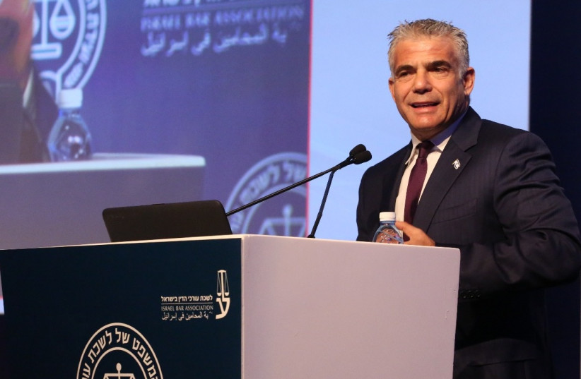 Yair Lapid speaks at a conference (photo credit: YONAH JEREMY BOB)