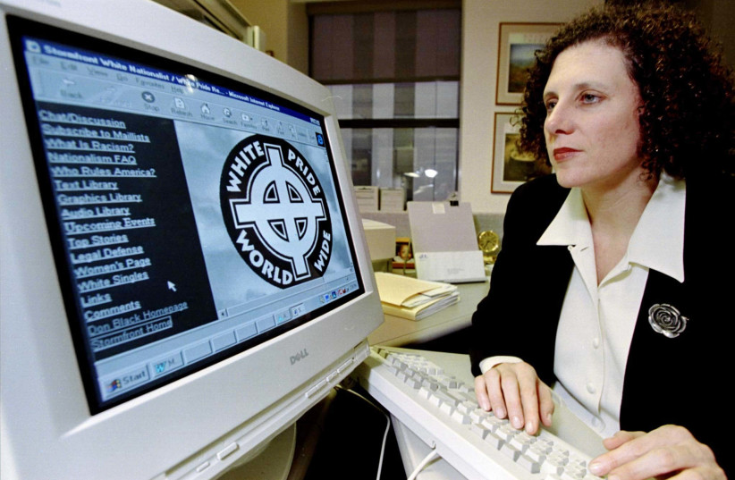 Anti-Defamation League Civil Rights Counsel Lauren Levin looks at a white supremacist web site run by an organization called Stormfront. (photo credit: REUTERS)