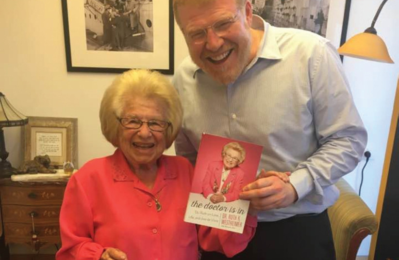 DR. RUTH with David Rozenson and her book 'The Doctor Is In.' (photo credit: DANA BAR SIMAN TOV)