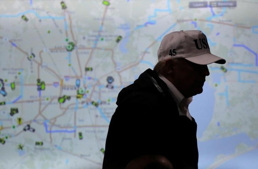 US President Donald Trump walks in front of a map of Houston during a briefing on Tropical Storm Harvey relief efforts at the Texas Department of Public Safety Emergency Operations Center in Austin, Texas, US, August 29, 2017.  (photo credit: REUTERS/CARLOS BARRIA)