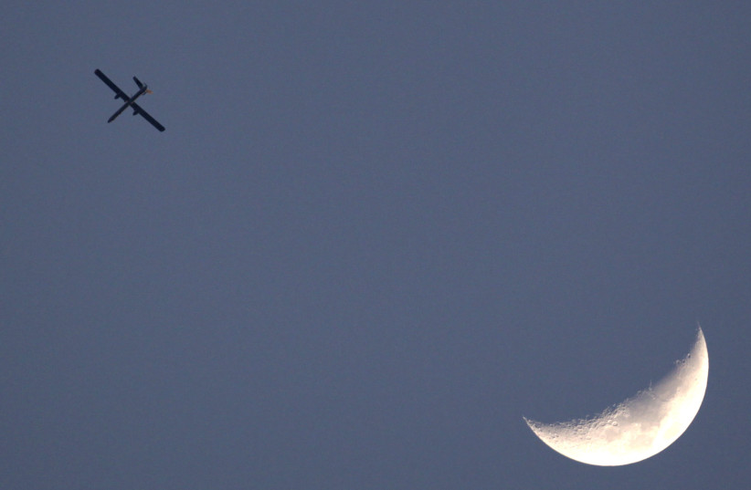 An Israeli drone is seen flying over Gaza as seen from the northern Gaza Strip border, April 9, 2011. (photo credit: REUTERS)