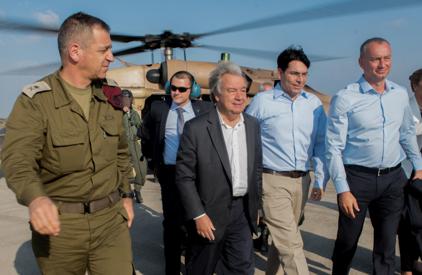 UN Secretary General Antonio Guterres (C) is accompanied by Israel's Ambassador to the UN Danny Danon as he tours the Gaza border (photo credit: IDF SPOKESPERSON'S UNIT)