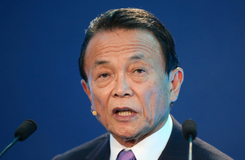 Taro Aso, Deputy Prime Minister, Minister of Finance and Minister of State for Financial Services of Japan, speaks during the Milken Institute Global Conference in Beverly Hills, California (photo credit: LUCY NICHOLSON / REUTERS)