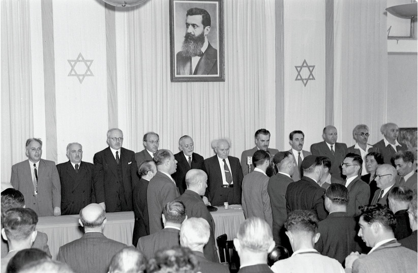 David Ben Gurion at the center as the state of Israel is declared May 14 1948 (photo credit: SCHERSCHEL FRANK/ GPO)