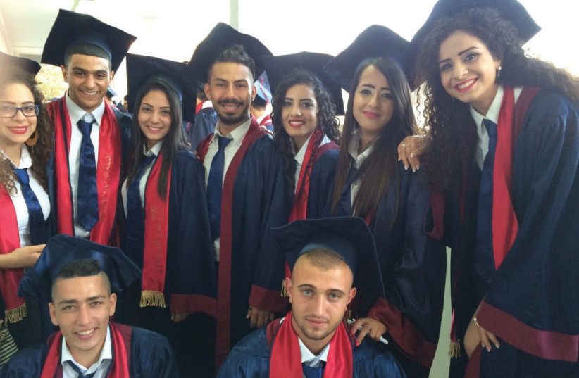 High school graduates celebrate receiving their diplomas in Kafr Yasif last year. (photo credit: SPERO SALAM)