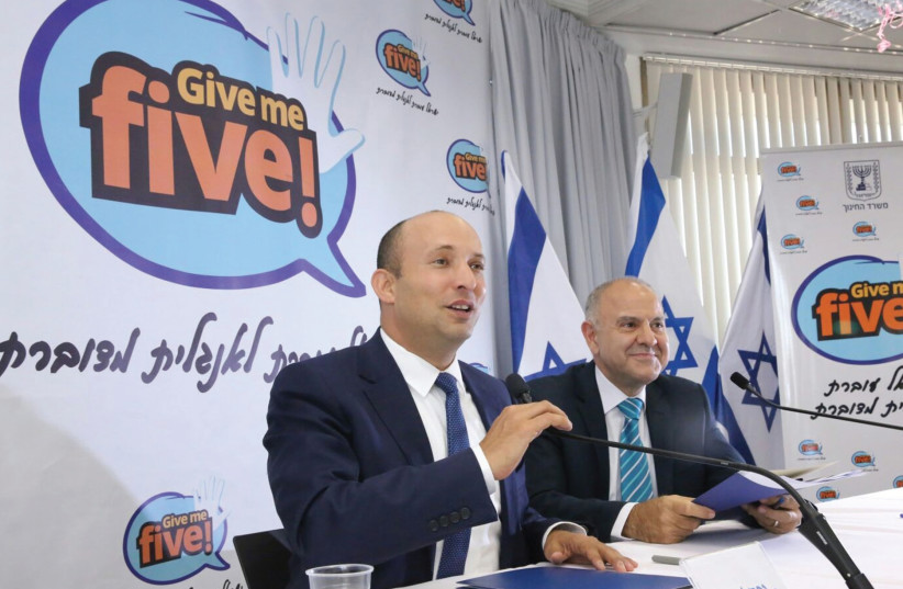 Education Minister Naftali Bennett (left) and Education Ministry director-general Shmuel Abuhav announce the 'Give Me Five!' reform to improve how English is taught in school. (photo credit: YOSSI ZAMIR)