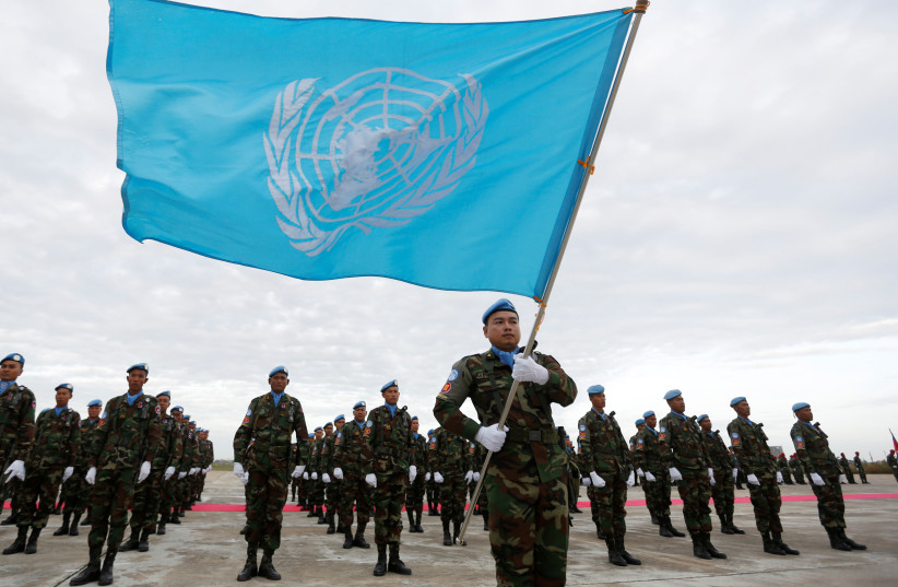 Cambodian soldiers serving with the United Nations Interim Force in Lebanon (UNIFIL), stand for their National Anthem during a send-off ceremony at Pochentong Air Base in Phnom Penh January 4, 2017.  (photo credit: REUTERS)