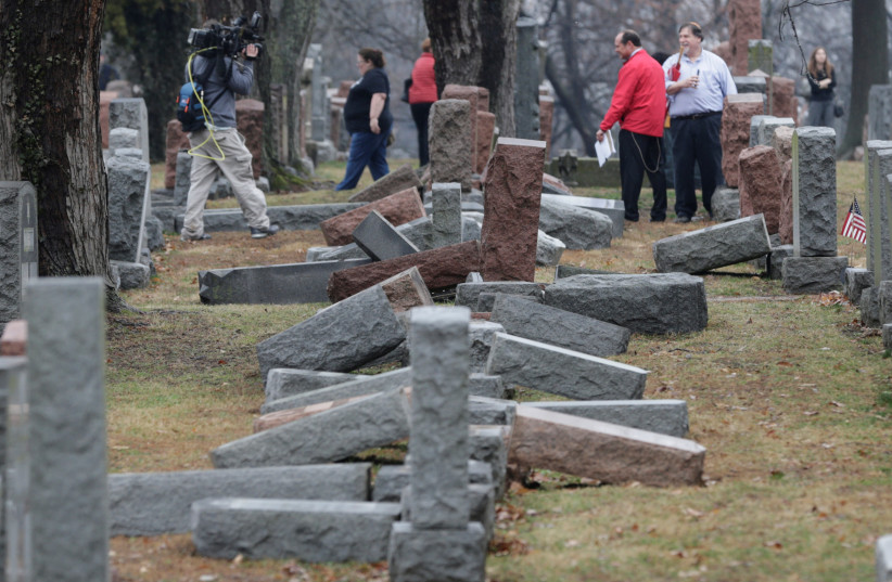 Media report on more than 170 toppled Jewish headstones after a weekend vandalism attack on Chesed Shel Emeth Cemetery in University City, a suburb of St Louis, Missouri, US, February 21, 2017.  (photo credit: REUTERS)