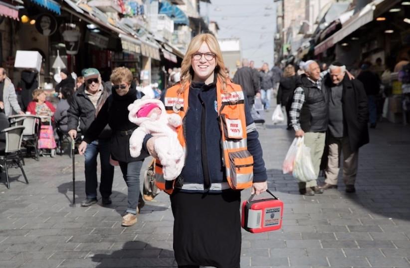 Miriam Ballin, holding her baby daughter, at the Mahane Yehuda market in Jerusalem. (photo credit: Courtesy)