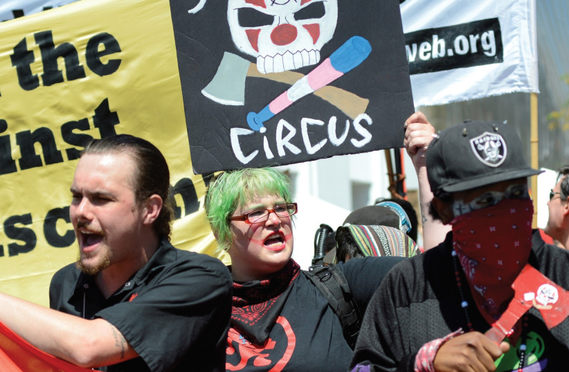 COUNTERPROTESTERS RALLY at a canceled No Marxism in America event in Berkeley, California (photo credit: REUTERS)