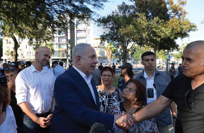 Prime Minister Benjamin Netanyahu tours south Tel Aviv (photo credit: AMOS BEN-GERSHOM/GPO)