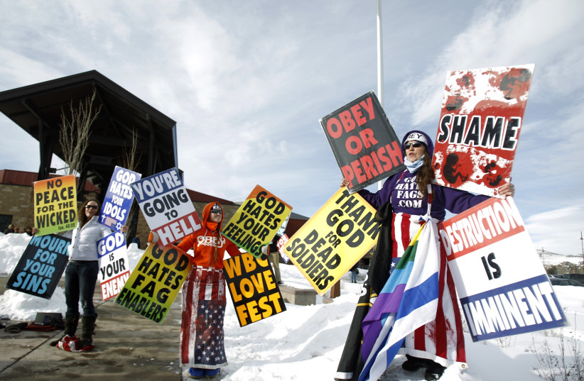 Members from the Westboro Baptist Church.  (photo credit: MARIO ANZUONI/REUTERS)