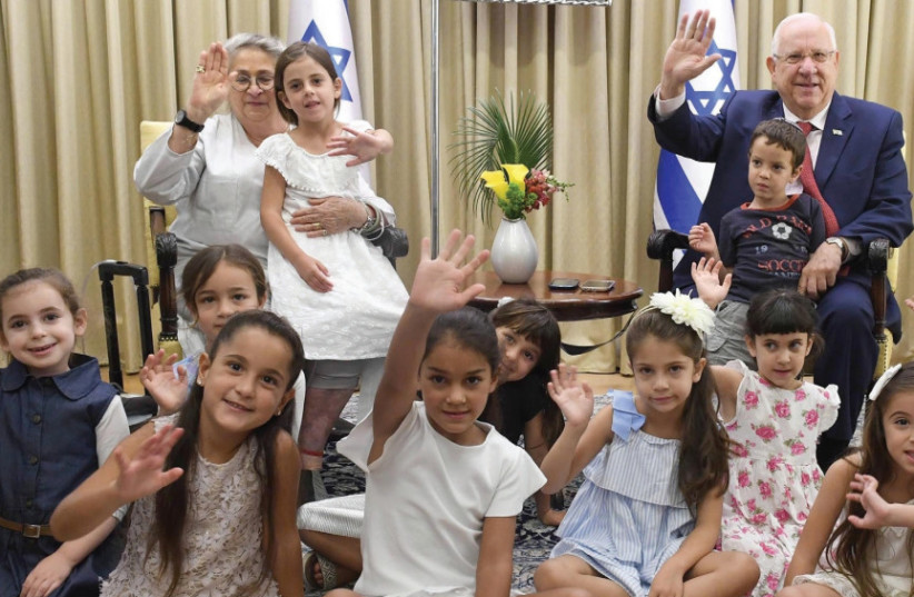 President Reuven Rivlin and his wife Nechama host the children of President's Residence staffers who will start first grade (photo credit: Mark Neiman/GPO)
