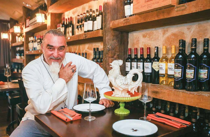 Shaul Ben Aderet poses in his restaurant, The Blue Rooster, in Tel Aviv. (photo credit: MARC ISRAEL SELLEM/THE JERUSALEM POST)