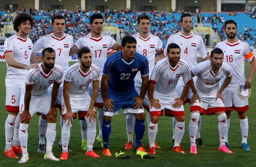 Syria's soccer team players pose for a photo before a friendly match against Vietnam. (photo credit: REUTERS)