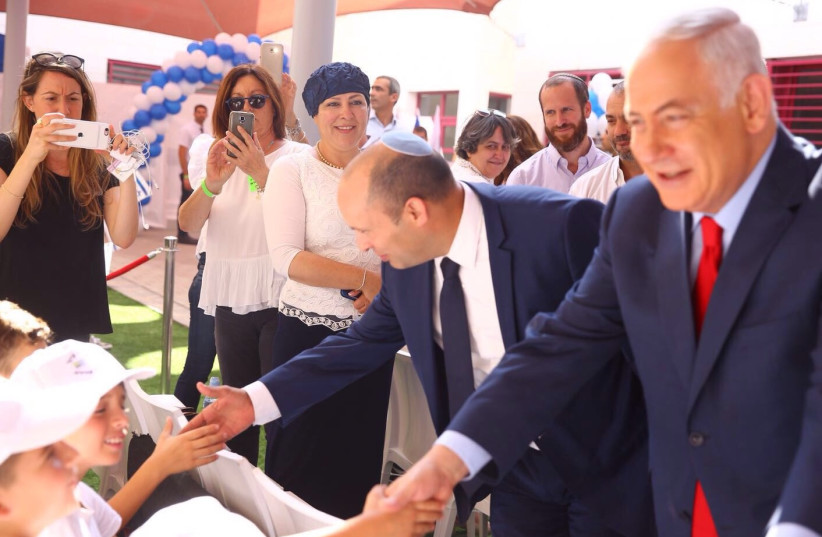 Prime Minister Benjamin Netanyahu and Education Minister Naftali Bennett greet students on the first day of school, September 2017 (photo credit: ODED KARNI)