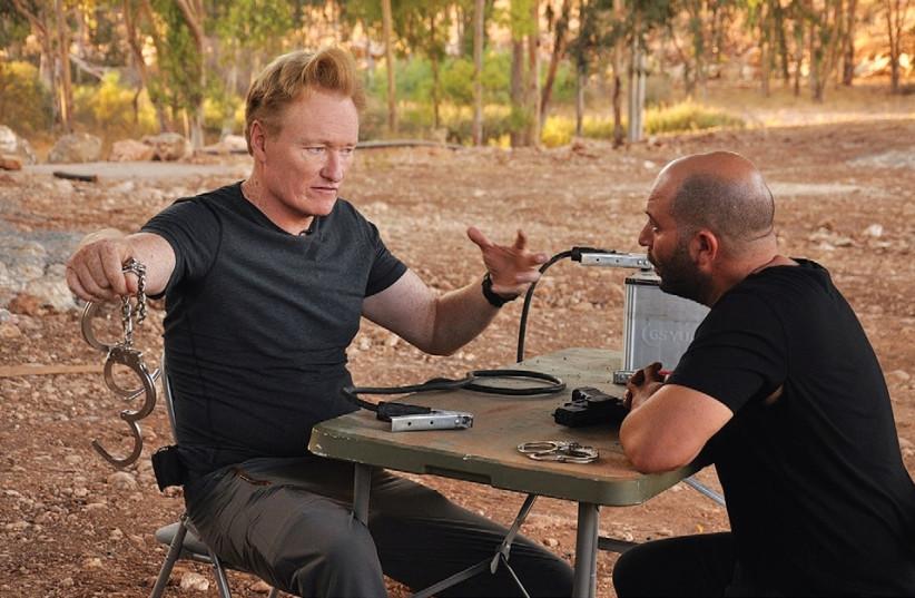 Conan O'Brien films a skit with Israeli actor Lior Raz on the set of 'Fauda.' (photo credit: YORAM SHAPIR)