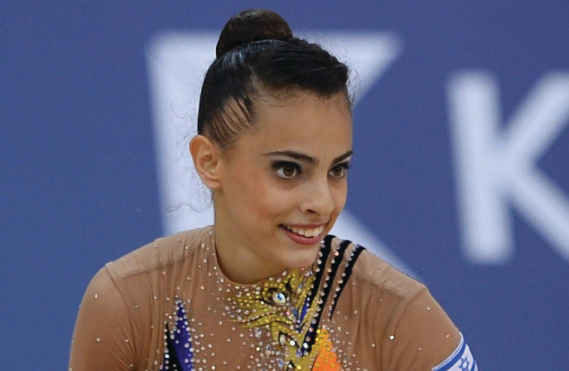 Israeli gymnast Linoy Ashram won an historic bronze medal in the all-around final at the World Rhythmic Gymnastics Championships final, September 1, 2017. (photo credit: OLYMPIC COMMITTEE OF ISRAEL)