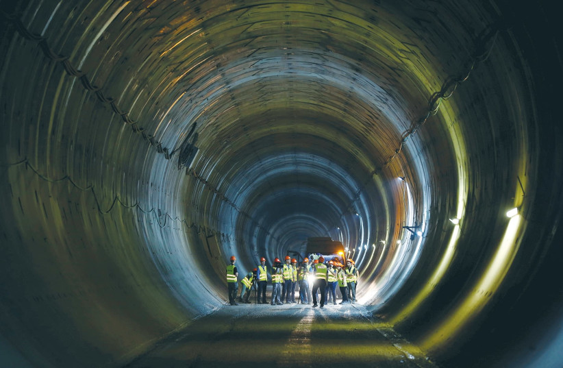 Members of the media tour one of the tunnels that will be part of the Tel Aviv-Jerusalem high-speed railway. (photo credit: RONEN ZVULUN / REUTERS)