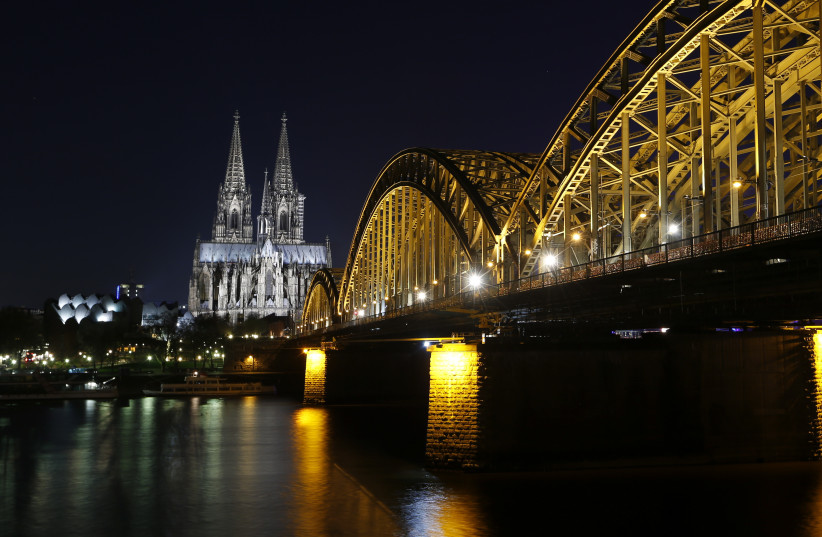 UNESCO World Heritage Cologne Cathedral and the Hohenzollern railway bridge along the Rhine (photo credit: REUTERS/INA FASSBENDER)