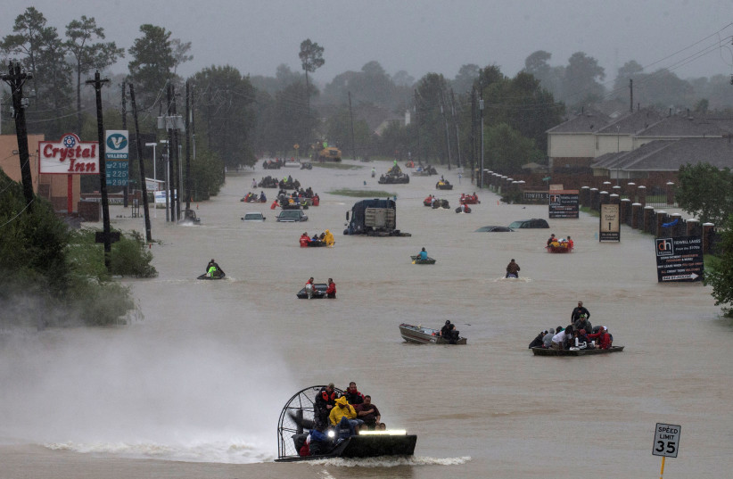 Residents use boats to evacuate flood waters from Tropical Storm Harvey along Tidwell Road east Houston, Texas (photo credit: REUTERS/ADREES LATIF)
