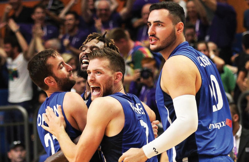 Israel's players know they have little time to celebrate the comeback win over Germany, with another must-win EuroBasket game coming up against Georgia at Yad Eliyahu Arena in Tel Aviv. (photo credit: ADI AVISHAI)