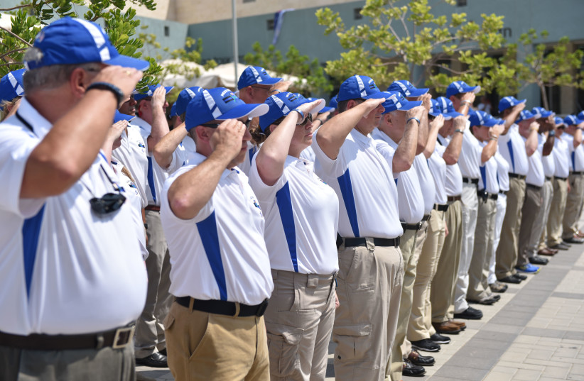 Members of the Police Unity Tour salute their Israeli counterparts at the Beit Shemesh police academy Monday. (photo credit: POLICE SPOKESPERSON'S UNIT)