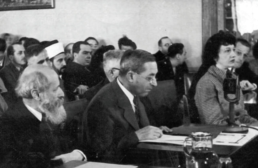 Martin Buber (left) and Judah Magnes (center) testifying before the Anglo- American Committee of Inquiry in Jerusalem in 1946. (photo credit: Wikimedia Commons)