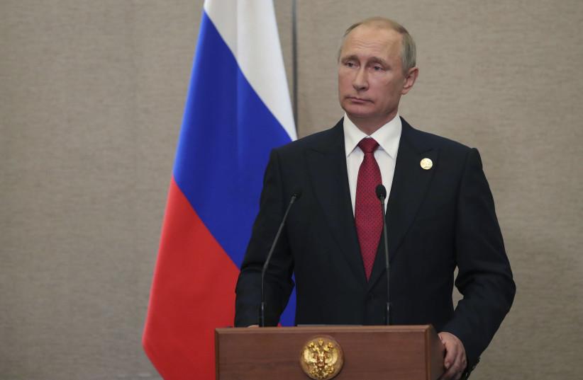 Russian President Vladimir Putin attends a news conference (photo credit: SPUTNIK/MIKHAIL KLIMENTYEV/KREMLIN VIA REUTERS)