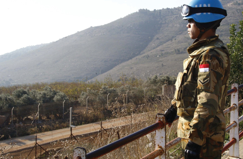 A PEACEKEEPER of the United Nations Interim Force in Lebanon (UNIFIL) stands at a lookout point in the village of Adaisseh near the Lebanese-Israeli border. (photo credit: REUTERS/KARAMALLAH DAHER)
