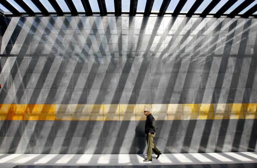 A man visits the entrance of the Holocaust memorial in Bucharest, Romania (photo credit: REUTERS/BOGDAN CRISTEL)