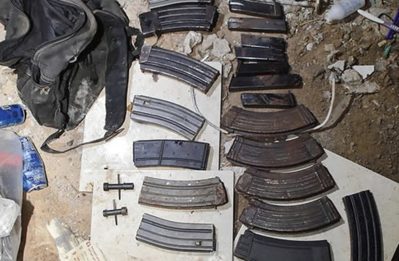 These weapons were seized during raids in the North that led to the arrest of 33 wanted gangsters (photo credit: COURTESY ISRAEL POLICE)