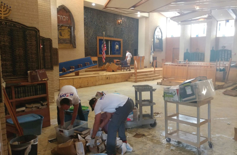 Workers clean the United Orthodox Synagogues of Houston on Sunday as part of restoration efforts by Jewish volunteers after Hurricane Harvey (photo credit: ZAKA)