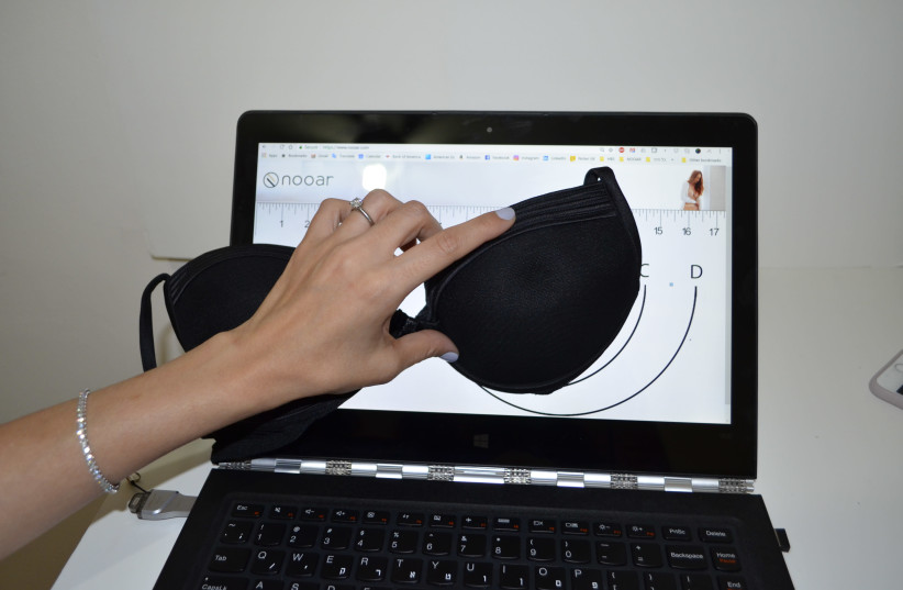 Nooar, an Israeli start-up lingerie firm, allows women to place their bra on a tablet or computer screen in order to customize the fit. (photo credit: COURTESY NOOAR)