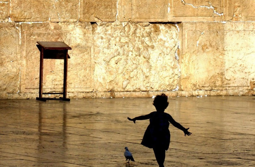A charming moment by the Kotel.  (photo credit: EZRA LANDAU)