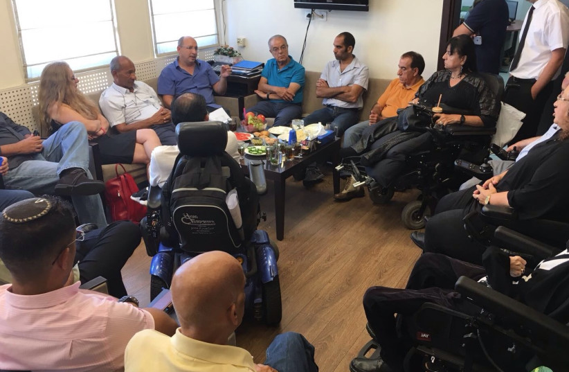 Histadrut president Avi Nissenkoren meets with leaders of the disabled community, September 5, 2017. (photo credit: DISABLED IS NOT A HALF PERSON)