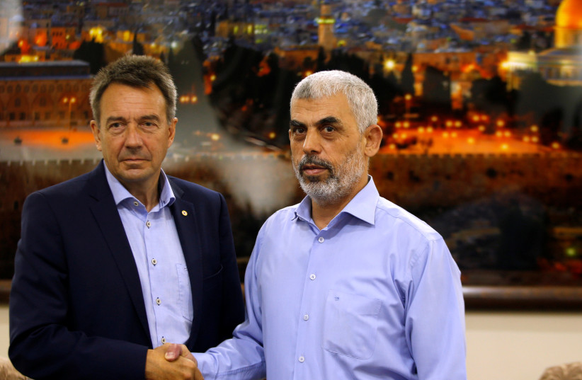 International Committee of the Red Cross (ICRC) President Peter Maurer (L) shakes hands with Hamas Gaza Chief Yehya Al-Sinwar during their meeting in Gaza City September 5, 2017. (photo credit: REUTERS)