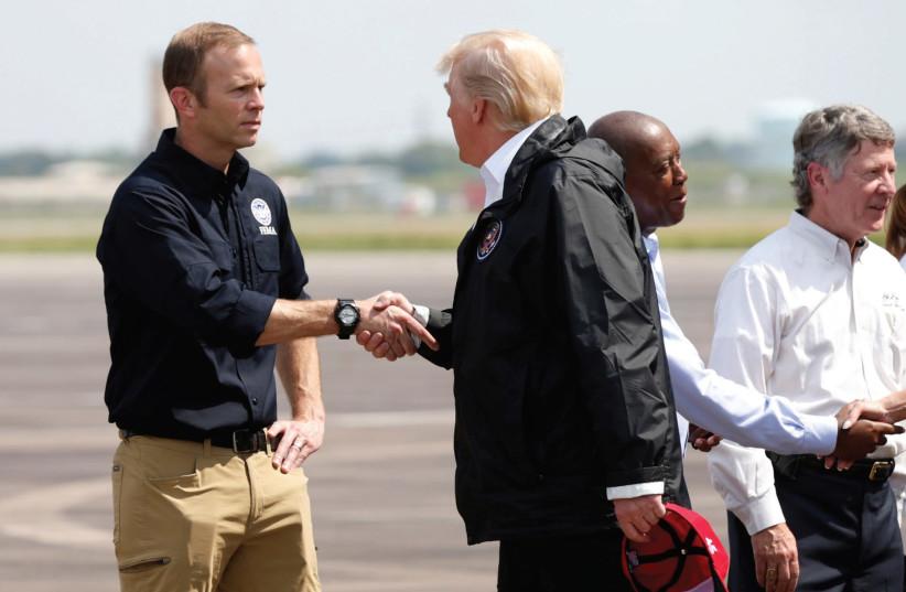US President Donald Trump meets FEMA Director Brock  (photo credit: REUTERS)