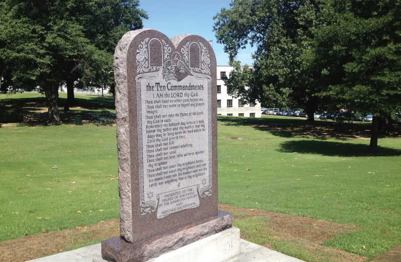 STATUE of the Ten Commandments is seen after it was installed on the grounds of the state Capitol in Little Rock, Arkansas in June. (photo credit: REUTERS)