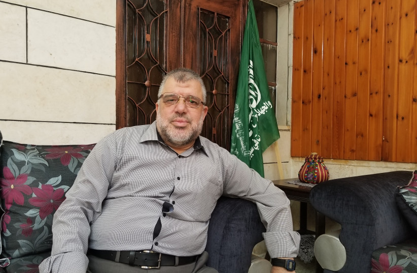 Hamas leader Hassan Yousif in his living room in Beitunia, a suburb of Ramallah, September 6, 2017. (photo credit: ADAM RASGON)