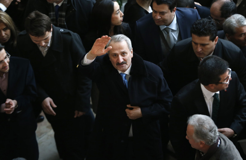 Turkey's former Economy Minister Zafer Caglayan waves as he arrives at a handover ceremony in Ankara  (photo credit: UMIT BEKTAS / REUTERS)