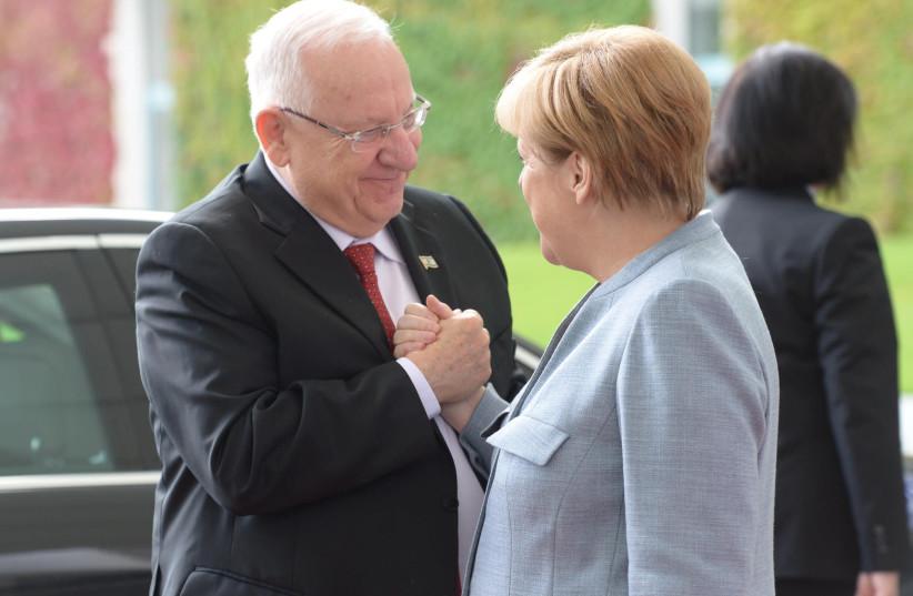 President Reuven Rivlin meets German Chancellor Angela Merkel in Germany (photo credit: AMOS BEN GERSHOM, GPO)