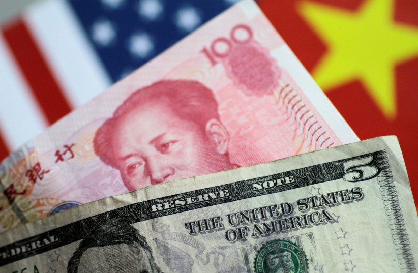 The Dollar and Yuan compete for influence. (photo credit: REUTERS)