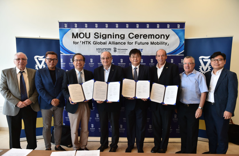 TECHNION PROFESSORS, including Prof. Daniel Weihs (left), sign a memorandum of understanding with partners from South Korea's KAIST University and Hyundai Motor Company in Haifa yesterday. (photo credit: Courtesy)
